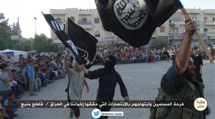 ISIL militants in (Manbij, Aleppo) Rejoicing over the capture of Iraqi city of Mosul.